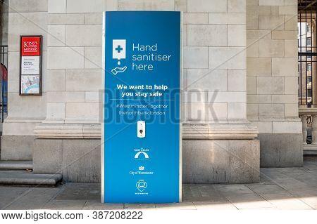 London - September 12, 2020: Free Public Hand Sanitiser Station Outside King's College London Bush H