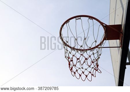 Old Green Board Of Basketball With Red Hoop And White-red Mesh On The White Sky Background. Basketba