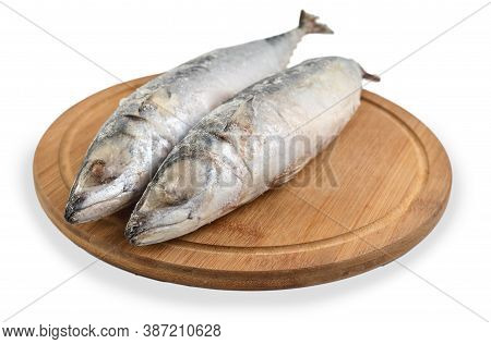 Frozen Mackerel Fish Isolated On White Background. Side View. Two Mackerels On The Board.