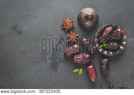 Dried Dates, Dried Fruit On Black Background. Top View Copy Space. Arabic Islamic Food