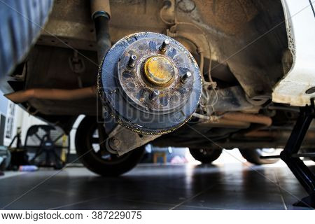 A Rear Hub Of The Car After Removing A Tire And Wheel, Maintaining A Brake And Wheel System, Car Jac