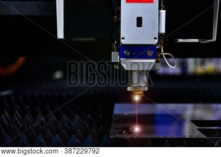 Industrial Laser Cut Machine While Cutting The Sheet Metal With The Sparking Light.