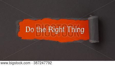 The Text Do The Right Thing Appearing Behind Torn Brown Paper