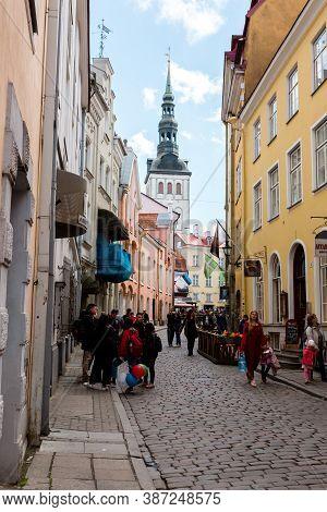 Tallinn, Estonia - May 25, 2019: People People Walking Down The Street In Old Town In Tallinn