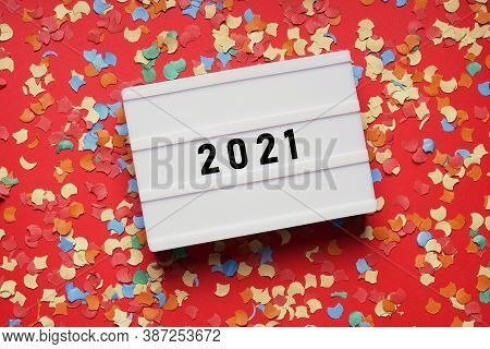 Year 2021 Lightbox Sign On Red Paper Background With Confetti - New Years Eve Party Celebration Conc