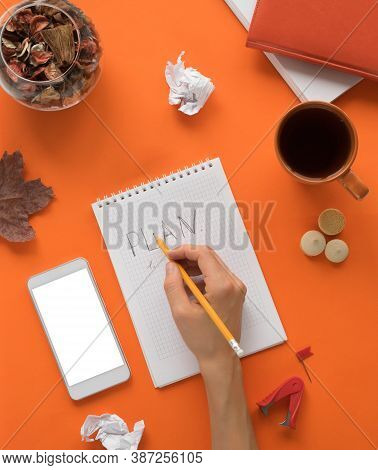 Desk Office Desk With Notepad Smartphone With White Screen And Other Materials With A Cup Of Tea Wit