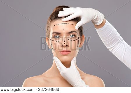 Concept Of Plastic Surgery. Young Woman Getting Treatment At Cosmetology Clinic, Changing Her Appear