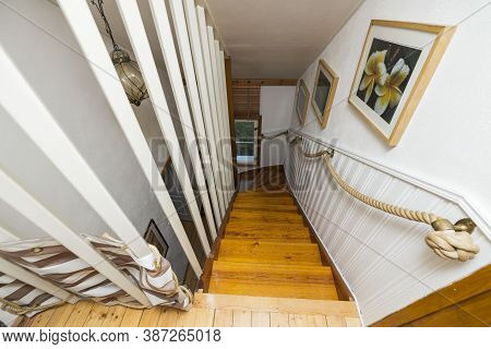 Close Up View Of Wooden Descending Stairs With White Railings. Interior Concept. 08.20.2020. Aby. Sw
