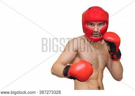 Young Man In Red Boxing Gloves And Helmet Isolated On White Background, Severe Look Of A Boxer, Spor
