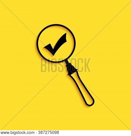 Black Magnifying Glass And Check Mark Icon Isolated On Yellow Background. Magnifying Glass And Appro