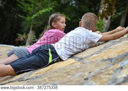 Two Children, Girl And Boy Having Fun Together In Nature. Brother And Sister Happy Friendly Play Tog