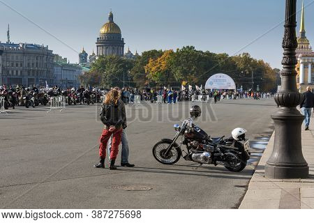 St Petersburg, Russia-september 26, 2020: Bikers Couple, Man And Young Woman Stands Backs On The Bac