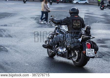 St Petersburg, Russia-september 26, 2020: Biker In Leather Gear On His Motorcycle Is Riding The Stre