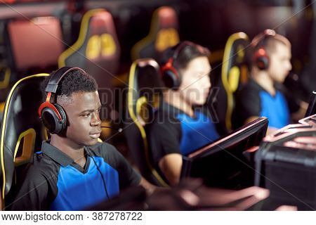 Team Of Young Professional Cybersport Gamers Wearing Headphones Participating In Esport Tournament