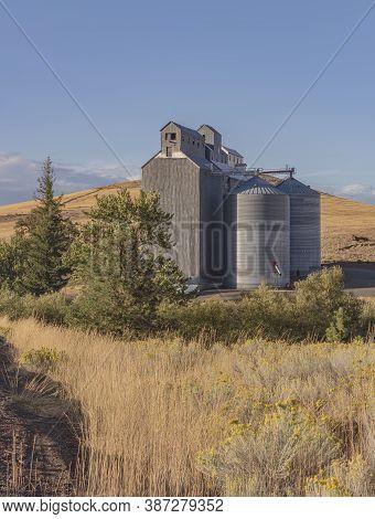 Grain Silos And Surrounding Landscape In Dufur Oregon.