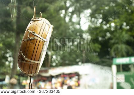 Wooden Tabla hanging in outside of the shop