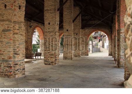 Restored Brick Colonnade To House The City Market, Italian Middleage Style. High Quality Photo