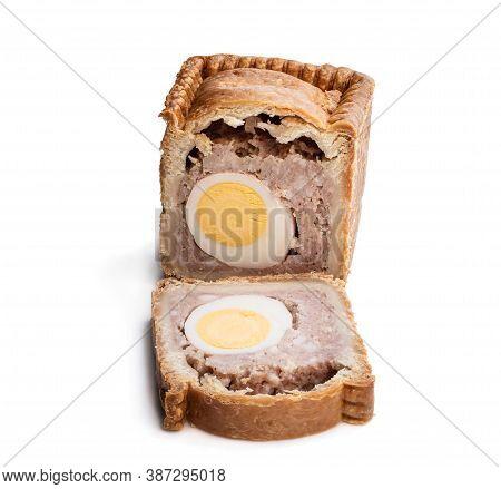 Traditional  English Savoury Gala Egg Pork Pie Isolated On White