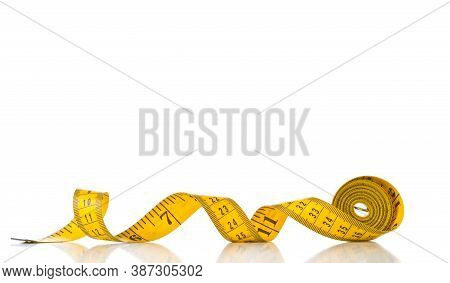 Tape Measure Sewing Tool Over White Background With Selective Focus