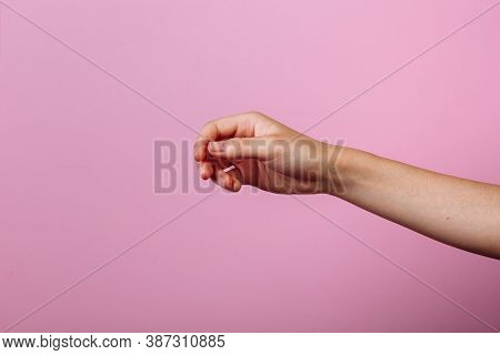 Instruction: How To Hold Chopsticks Eat With Chopsticks. Isolated On Pink Background. Step 1.