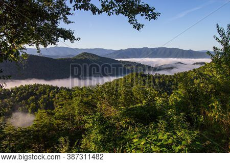 Misty Smoky Mountain Sunrise. Mist In The Valley Of The Great Smoky Mountains National Park As Seen