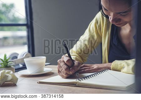 Planner Write Meeting Agenda At Calendar, Work Online At Home. Hand Of Asian Woman Planning Daily Ap
