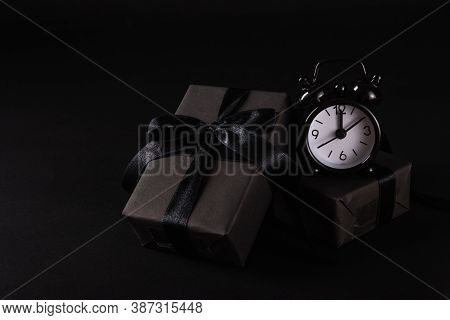 Black Friday Sale Shopping Concept, Top View Of Gift Box Wrapped In Black Paper And Black Bow Ribbon