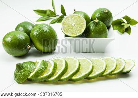 Green Lemon Tahiti Or Citrus Latifolia, Isolated On Neutral Background.