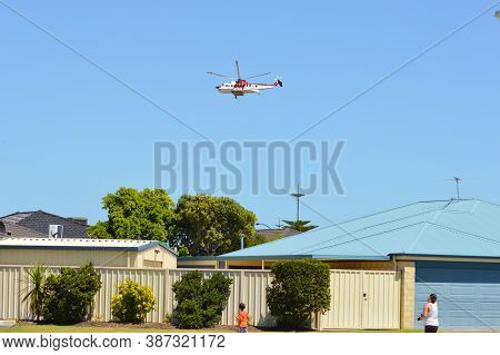 Port Kennedy, Wa / Australia - 02/24/2013 Firefighting Helicopters Drawing Water From The Local Pond