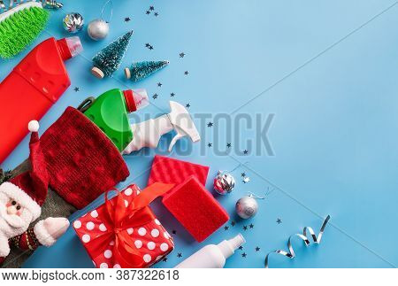 Cleaning Tools And Materials In Christmas Stocking Top View Flat Lay