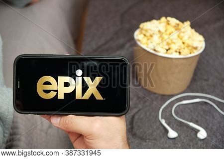Epix Logo On The Smartphone Screen With Popcorn Box And Apple Earpods On The Background, September 2