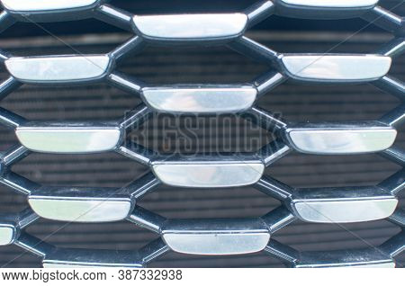 Mesh Machine. Radiator Grille. Metal Texture. The Radiator Grill Is Large Powerful. The Front Of The