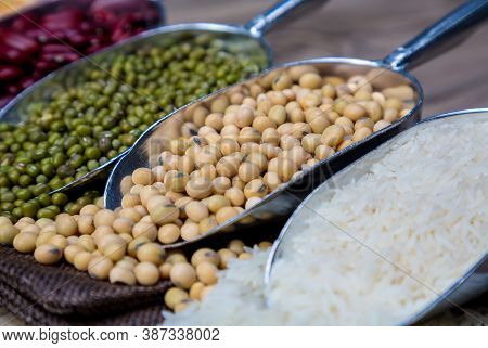 Soybean Or Soya Bean In A Bowl On Wooden Background. Soybeans With Spoon And Blow. Soybean Organic B
