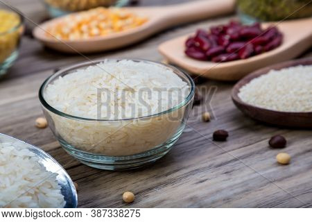White Rice Or Thai Jasmine Rice In  Bowl On Wood Background. White Rice Grain In  Bowl.