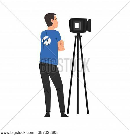 Male Video Operator Looking Through Professional Camcorder On Tripod, Television Industry Concept Ca