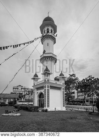 George Town, Penang, Malaysia - December 1, 2019: The Minaret Of The Kapitan Keling Mosque. It Was B