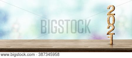 Happy New Year 2021 Wood With Sparkling Star On Brown Wood Table With Green Bokeh Background,holiday