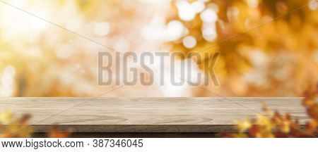Autumn Background.empty Old Rustic Wood Table With Blur Forest Tree With Sunlight,autumn Fall Backdr