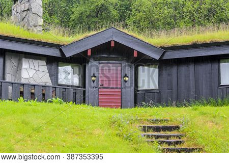 Black Wooden Cabin Hut With Overgrown Roof In Hemsedal, Norway.