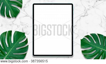 Top View Of Tablet On White Marble Table Background.