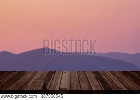 Empty Top Of Old Wooden Table With Fresh Morning Atmosphere In Natural Landscape Background.