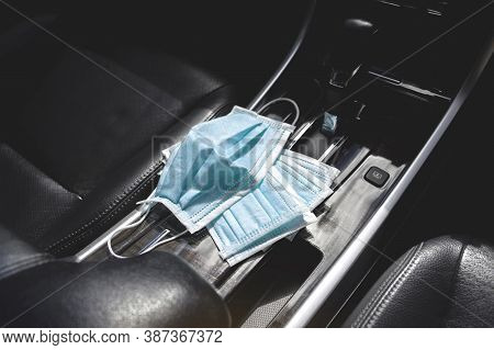 Medical Face Mask Placed On Center Console Inside To The Car , Coronavirus (covid-19) Prevention Con