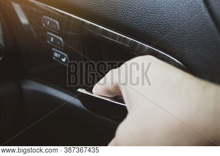 The Driver's Hand Unlocks The Door Handle Inside The Car To Open The Car Door