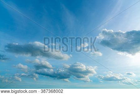 Beautiful Blue Sky And White Cumulus Clouds Abstract Background. Cloudscape Background. Sky And Clou