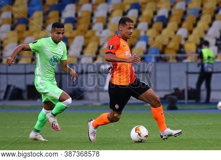 Kyiv, Ukraine - August 5, 2020: Joao Victor Of Vfl Wolfsburg (l) Fights For A Ball With Alan Patrick