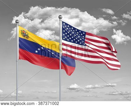 Two Realistic Flags. United States Of America Vs Venezuela. Thick Colored Silky Flags Of America And