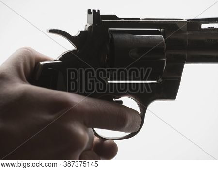 Person With A Revolver In Hand