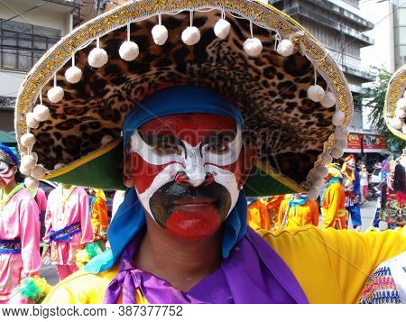 Bangkok, Thailand, November 14, 2015: A Man With His Face Painted In Bright Colors In A Festival Of