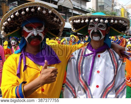 Bangkok, Thailand, November 14, 2015: Two Men In Costume With Painted Faces In A Festival Of The Cla