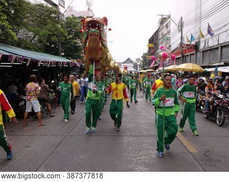 Bangkok, Thailand, November 14, 2015: A Group Of People Carry A Dragon In The Cavalcade In A Festiva